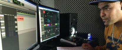 Male Music Production Intern is at a local Recording Studio mixing at a sound desk during his work experience in South Africa.
